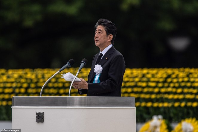 Abe (pictured) made a speech during the 75th anniversary of the Hiroshima atomic bombing during the ceremony that was scaled back significantly due to coronavirus