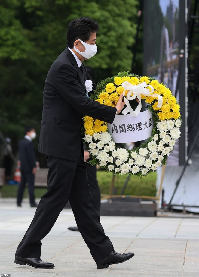 Prime Minister Shinzo Abe (pictured) was joined by survivors, their relatives and officials to mark the 8.15 am blast anniversary with a minute of silence at Hiroshima's Peace Memorial Park before laying a wreath