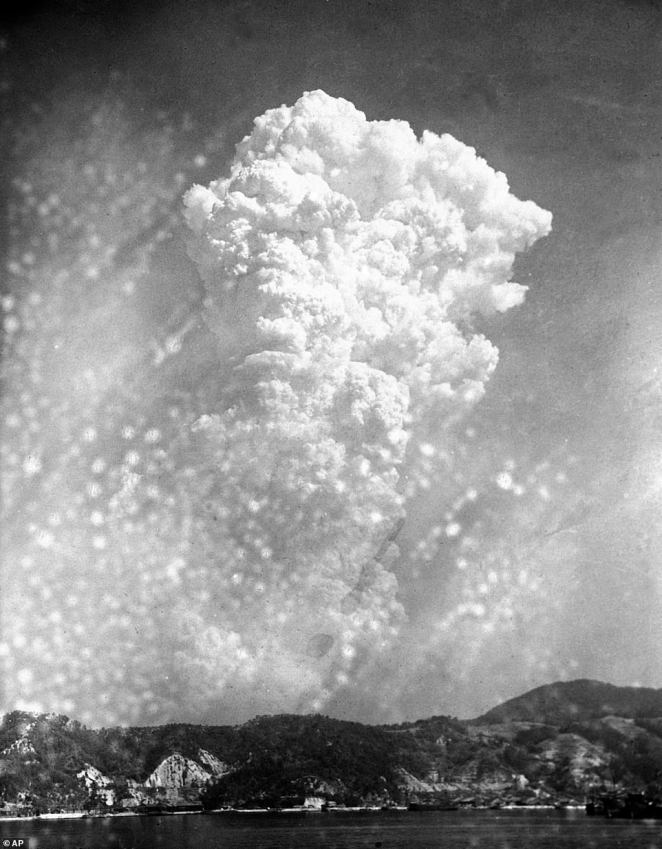 Smoke pictured rising 20,000 feet above Hiroshima, western Japan, after the first atomic bomb was dropped during warfare in August 1945