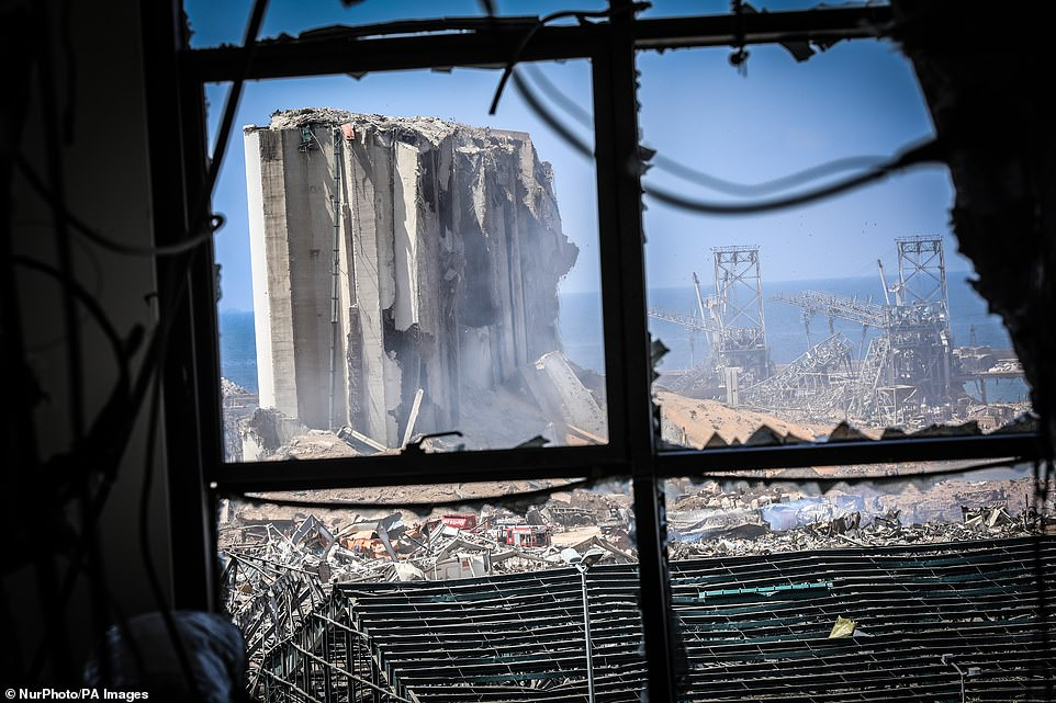 A view of the destroyed grain silo is visible through a blown-out window close to Beirut's port on Wednesday