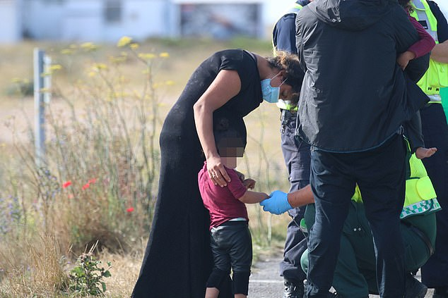A group of around 16 migrants including 10 kids and an eight-month pregnant woman landed on Dungeness beach, Kent, today