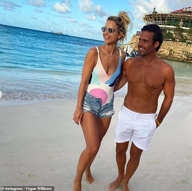 Fun in the sun: No stranger to a beach getaway, one snap showed a swimsuit-clad Vogue and Spencer gazing at the ocean views