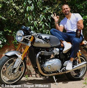 Fun: Another showed Spencer happily perched on one of his beloved motorbikes