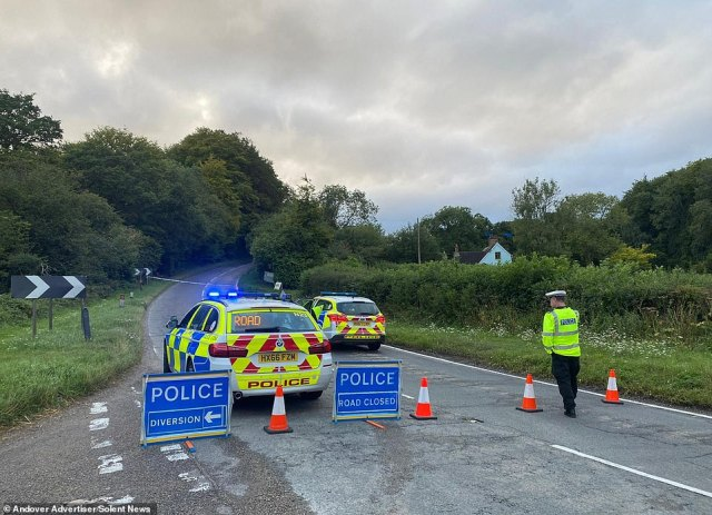 As police raced in pursuit of the motorbike, the rider crashed on the A343 in Hurstbourne Tarrant. Pictured: Police at the scene of the crash