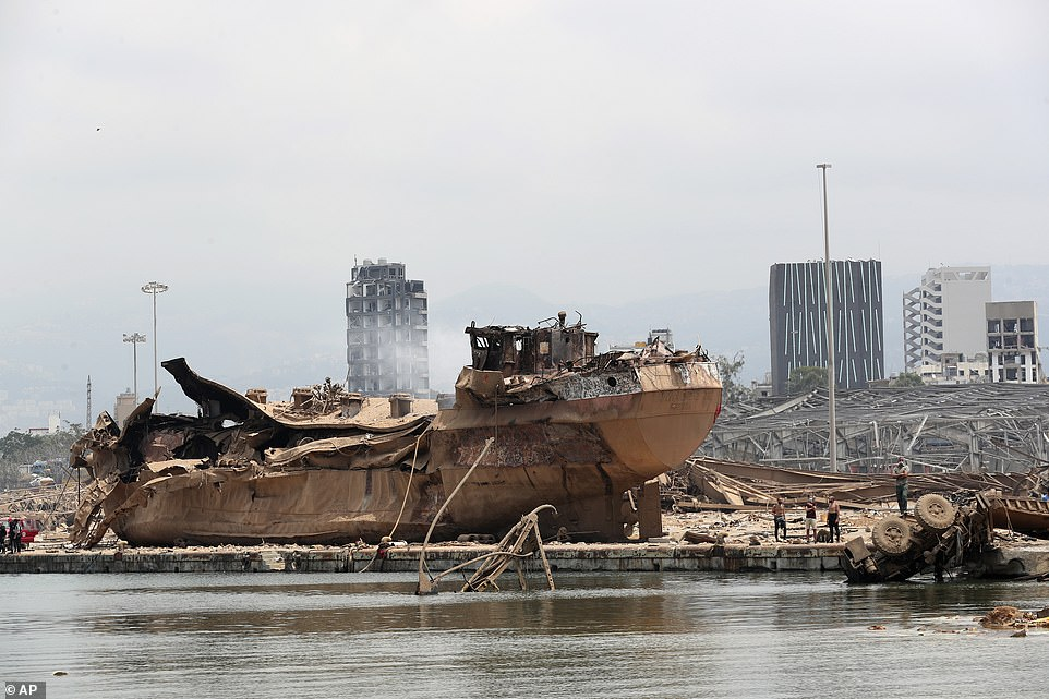 The explosion on Tuesday night, which was reportedly the size of a small nuke, has left at least 137 people dead and a further 5,000 wounded. Pictured: Wreckage of a ship devastated in the explosion