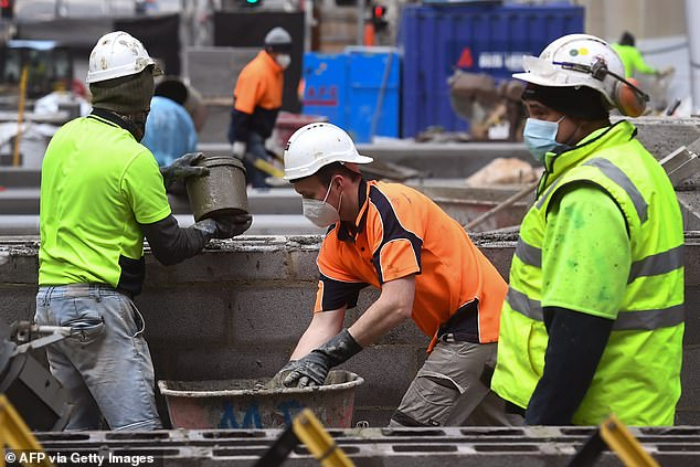 The construction industry has been hard hit with building sites restricted to 25 per cent capacity. Pictured are workers building a new park in Melbourne's CBD on Thursday