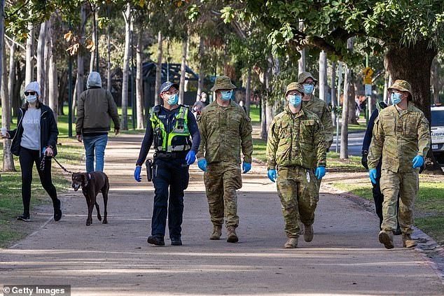 Australian Defense Force (ADF) personnel and Protective service officers are seen on patrol