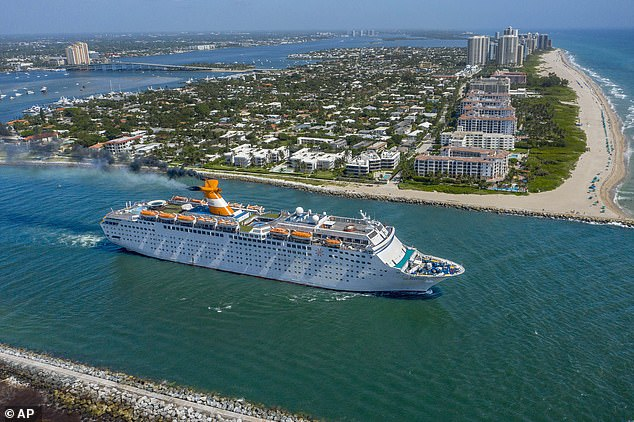 The Grand Celebration cruise ship sails through the Lake Worth Inlet between Palm Beach and Singer Island in Florida in July. A lawsuit claimed this weeks that crew members are'effectively held hostage' onboard theBahamas Paradise Cruise Line ship due to the pandemic