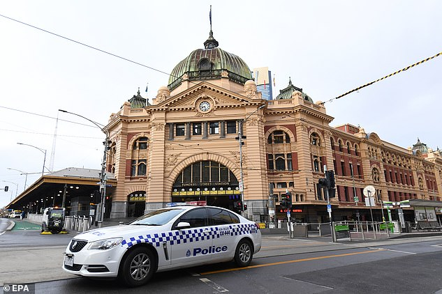A police car is pictured parked outside Flinders Street Station in Melbourne on Thursday morning