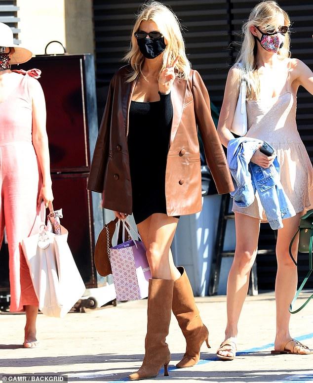 Charlotte McKinney rocks LBD and stiletto boots as she celebrates 27th birthday at Nobu Malibu