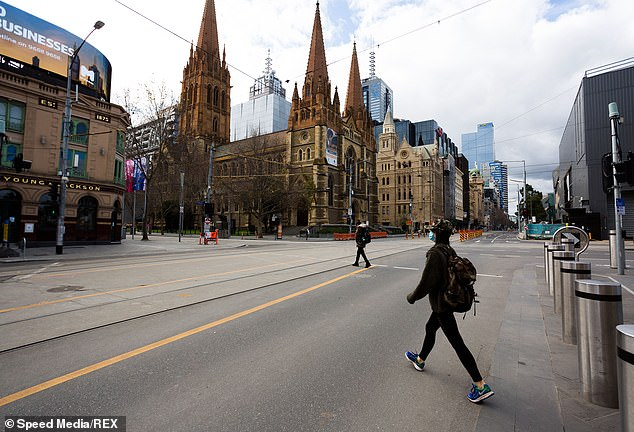 The Flinders and Swanston Street intersection, which is usually filled with thousands of commuters, was almost empty on Thursday