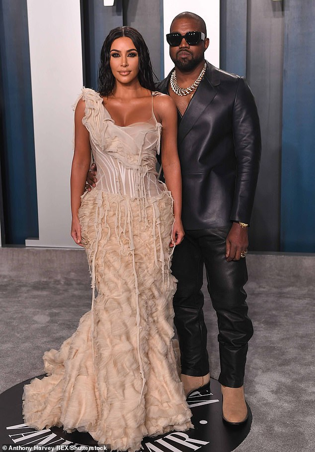 Last chance saloon:Though the photo's location was tagged from 'Somewhere in Malibu,' Kim is reportedly in the Caribbean trying to mend things with husband Kanye. They're seen in February 2020 above