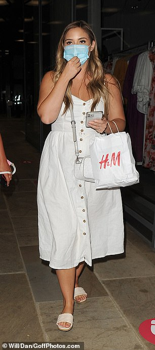 Spot of shopping: Jacqueline toed a H&M carrier bag in her hand