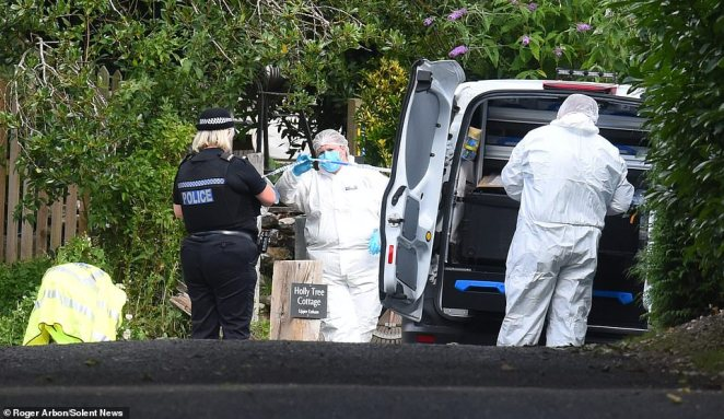 According to a local council chief, police believe the rider was responsible for the shooting and officers 'are not looking for anyone else'. Pictured: A police forensic team at the scene of the shooting in Upper Enham