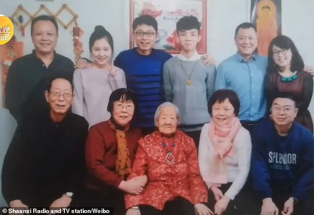 Ms Liu is pictured with her family, which has five generations and is headed by the centenarian