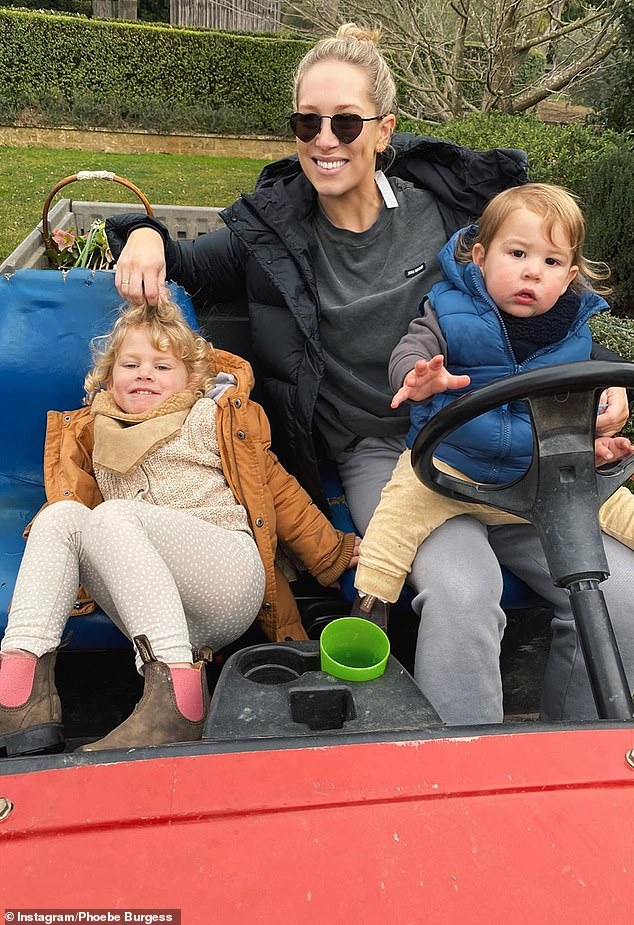 Motherhood: The mother-of-two shares her children - daughter Poppy, three, and son Billy, one - with ex husband Sam Burgess. Phoebe pictured with Poppy and Billy