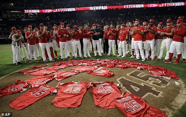 Members of the Los Angeles Angels place their jerseys with No. 45 in honor of pitcher Tyler Skaggs on the mound after a combined no-hitter against the Seattle Mariners. Skaggs died of a drug overdose earlier in July