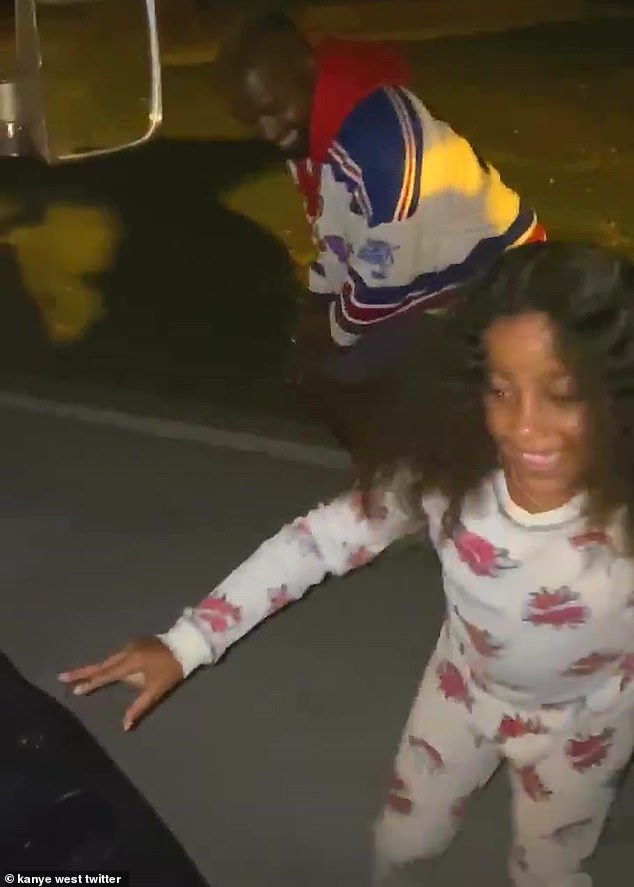 So sweet: In his version of the video, Kanye, 43, was joined by his eldest daughter as they got out of their vehicle to shake their leg in the street