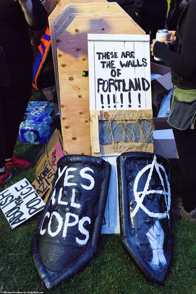 The group, in Laurelhurst Park, lined up to claim their 'armor' for Friday night's protest