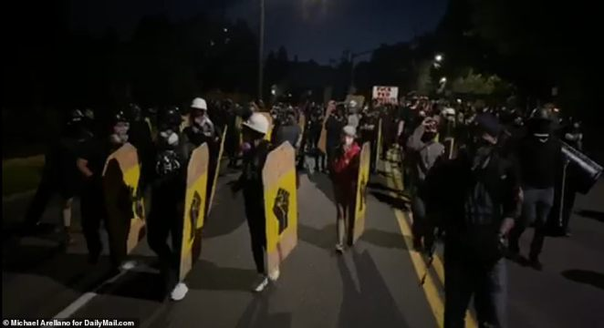 Protesters in Portland took to the streets with makeshift shields on Friday night