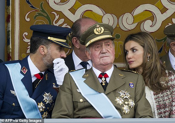King Felipe pictured with former King Juan Carlos and Spanish Queen Letizia during the Spanish National Day military parade in Madrid on October 12, 2012