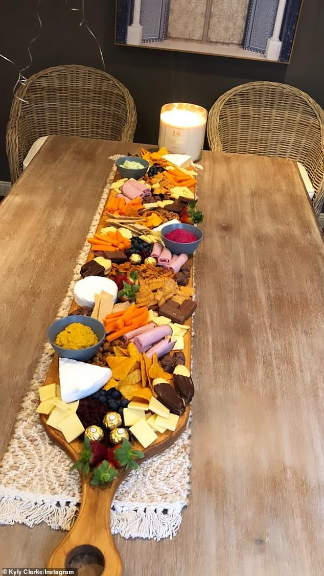 What a treat: A large dining table featured a grazing board complete with gourmet antipasto andFerrero Rocher chocolates