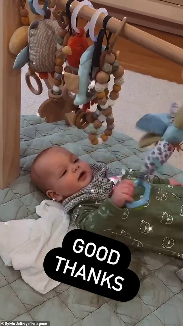 Play time: The 34-year-old shared videos on her Instagram Storyies of her little one lying on his back as he played with his toys hanging above him, with the caption: 'good thanks'