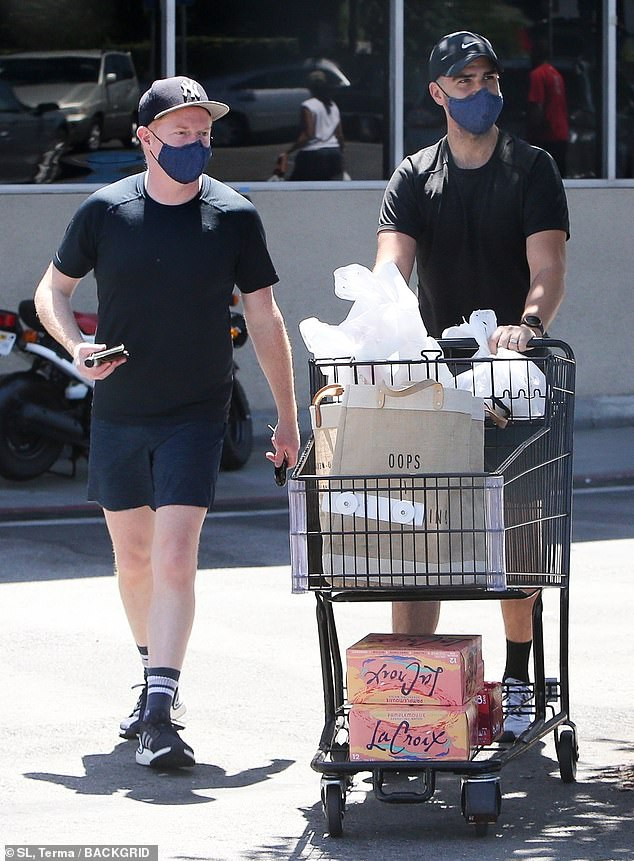 Heating up: Justin attempted to shade himself from the blazing Los Angeles sun with a black Nike cap