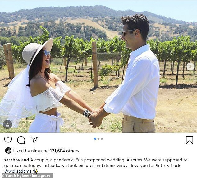 To mark the day they were supposed to get married: Sarah Hyland took to her Instagram with fiance Wells Adams to share a joyous photo spread with the pair wearing bridal white