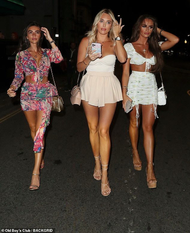 Work it: Amber and her glam gals looked sensational as they strutted out of the restaurant
