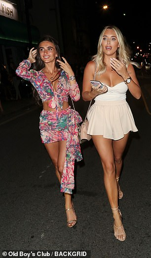 Style: The women flaunted their toned and tanned legs as they left Sexy Fish