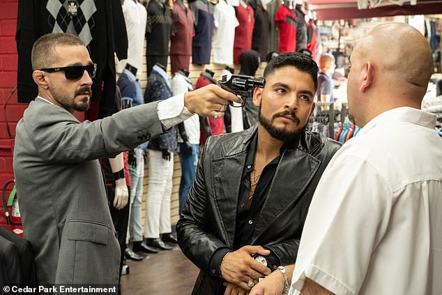 Critics have savaged David Ayer's new film, The Tax Collector, which stars Shia LaBeouf (left) and Bobby Soto (right) and premiered August 7