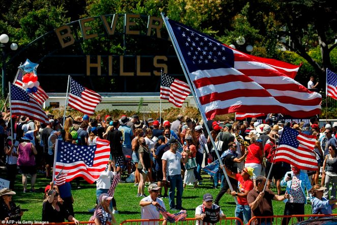 The Beverly Hills Police Department said the hundreds of demonstrators gathered at the Beverly Hills sign at Beverly Gardens Park around 2pm (pictuerd)