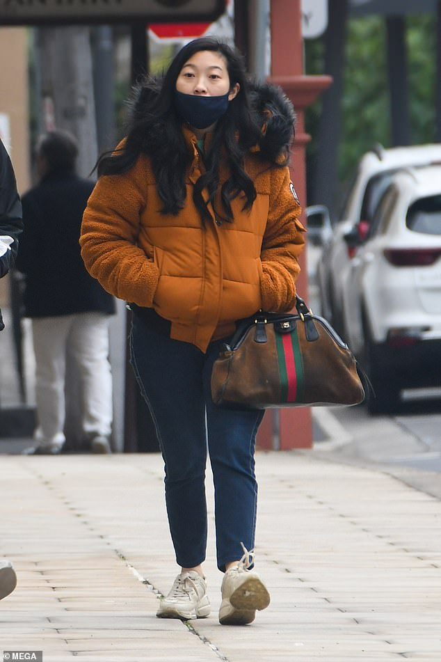Calm before the storm: Awkwafina, 32, enjoyed a casual walk in Sydney on Saturday afternoon before cameras officially rolled on Marvel's Shang-Chi and the Legend of the Ten Rings