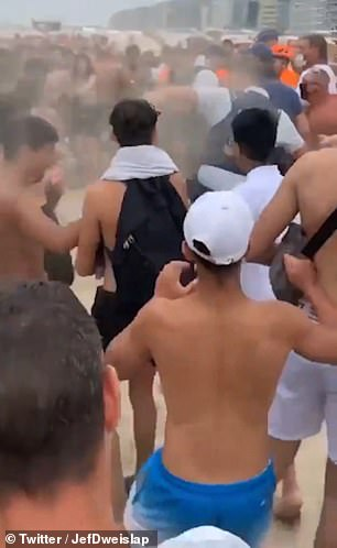 It shows bathers in conflict with the police