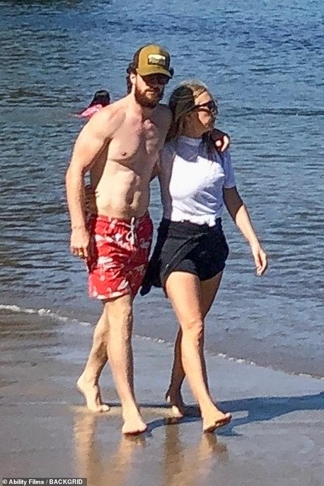 Romantic: Aaron Taylor-Johnson, 30, and his wife Sam, 53, put on an affectionate display as they went for stroll together along the beach in Malibu on Saturday