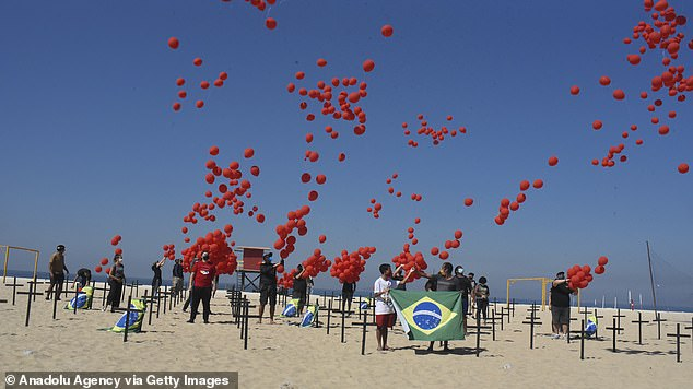 On Saturday, Brazil's health ministry confirmed 49,970 new confirmed cases and 905 deaths within the previous 24 hours.Pictured, a thousand red balloons were released in Rio de Janeiro in tribute for the victims