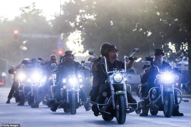 Motorcyclists ride down Lazelle Street during the 80th Annual Sturgis Motorcycle Rally on Saturday not wearing masks