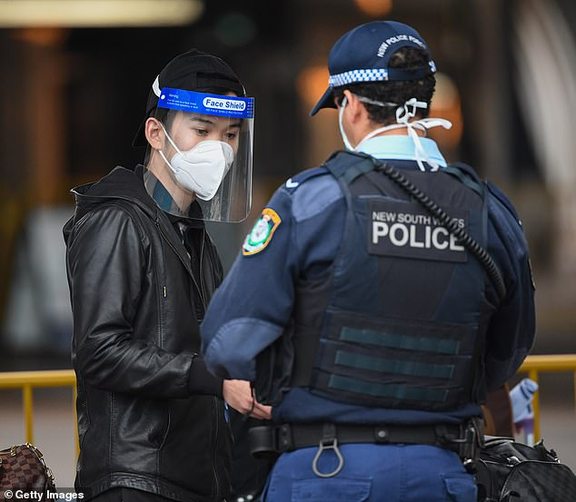 Dr Coatsworth's comments came as NSW recorded just 10 new infections in the 24 hours to 8pm on Saturday, including a healthcare employee in northern Sydney (an airline passenger pictured being screened by police)