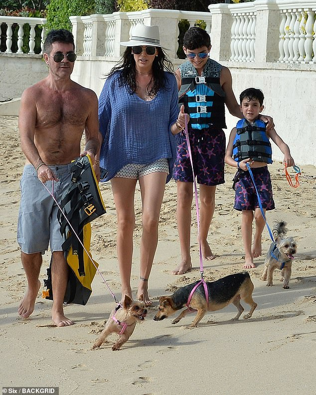 Family: He was outside in the courtyard of his Malibu home with his son Eric, six, and stepson Adam, 14, when the fall occurred (pictured together in Barbados in December)