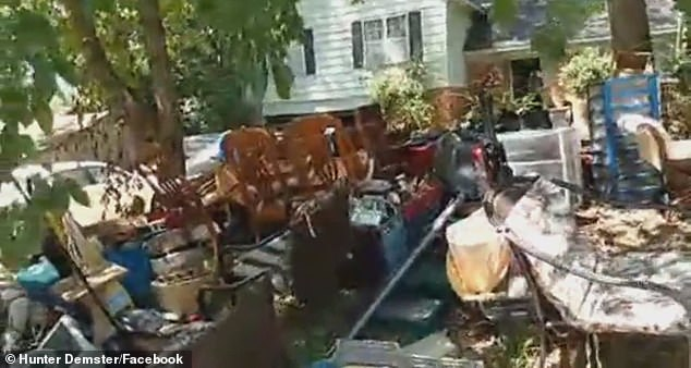 In June, Tennessee officials ended the moratorium on home evictions put in place at the start of the pandemic. Pictured: Nelson's belongings stacked on the front lawn of his home
