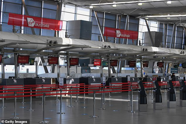 The Australian Federation of Travel Agents has warned that 21,900 jobs have been lost so far, 74 per cent of which were full time positions. (A deserted Sydney Airport on August 5)