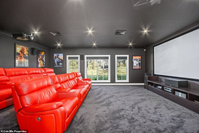 The five-bedroom home features a wealth of incredible features including an epic cinema room with red leather chairs