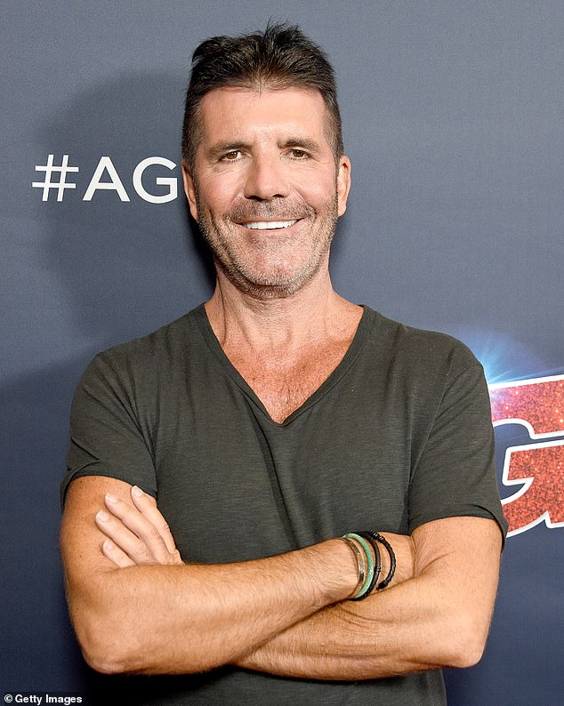 Painful:Simon Cowell broke his back when his new $21,500 electric bike 'flew up in the air' after he tried to change gears while riding it in the courtyard of his Malibu home