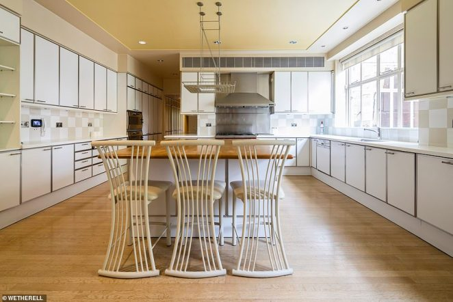 Meanwhile the palatial property also features an enormous family kitchen in the property with a central island and breakfast bar