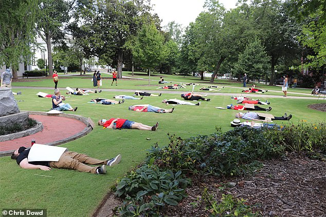 Symbolism: University of Georgia staff and students staged a 'die-in' demonstration last week in protest of the school's re-opening plans