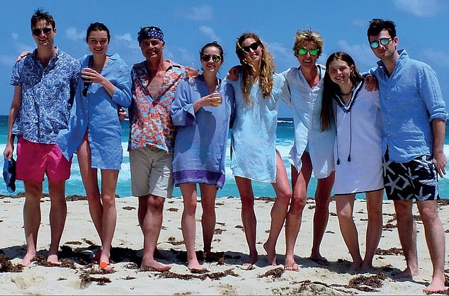 Mick May (third from left) with his children (left to right) Ivo, Honor, India-Rose, Lara, wife Jill, Daisy and Paddy