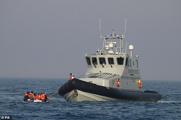 Prepare to board: The crew of the Border Force cutter secure the rubber dinghy mid-Channel. In the last five years the UK has given France £114million to fund operations against illegal migrants and people traffickers