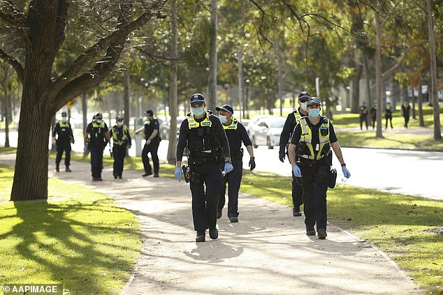 Premier Dan Andrewshad warned the time for leniency was over when he announced the tougher restrictions on Sunday, August 2 (Pictured, police in Melbourne)