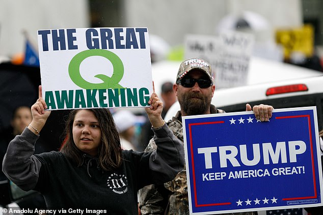 Supporters of the QAnon theory protest in Oregon in May. Facebook has conducted an internal investigation into the conspiracy theorists, and found that millions back the group